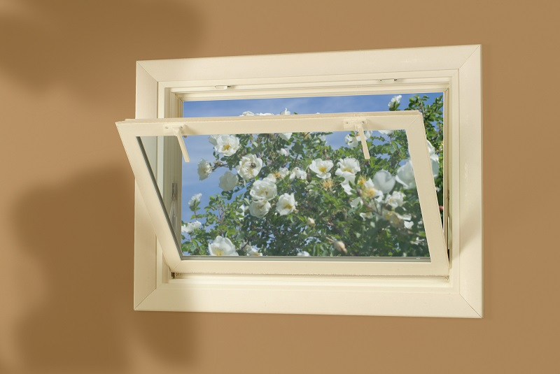 Hopper Style Window installed in a Basement