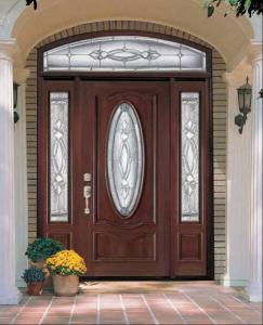 Entry door with decorative oval and side-lites with transom