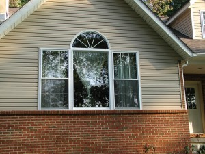 Triple unit window with circle top