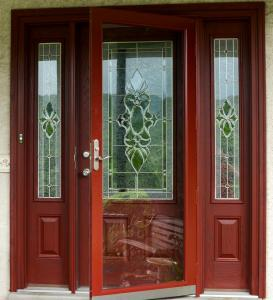 Full view storm door and entry door with decorative 3/4 view and 2 side-lites
