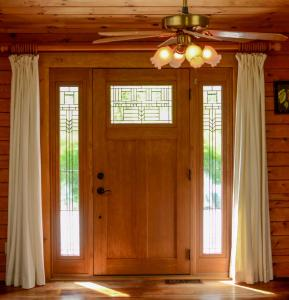 Entry door with dentil shelf and side-lites, oak stained (inside)