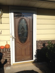 Entry door with decorative oval glass and full view storm door with decorative glass